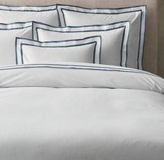RH's Italian Parallel Border Duvet Cover:FREE SHIPPINGFrom the atelier of Italian linen maker Carlo Bertelli, our bedding is framed by a crisp double border of cotton sateen. Expert tailoring produces the precisely mitered corners of each border stripe, adding strong definition to ultra-smooth white percale.