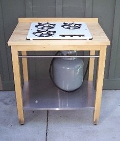 Build a stove for an outdoor kitchen with this Ikea hack. | Could I have a gas canning stove this way? hmmmm
