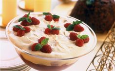 """The first known recipe for trifle – a wobbling concoction of custard, cream,    alcohol-soaked cake or bread and jelly – was published in the 1500s though    then it was little more than a flavoured milk cream. In Italy, there's a not    dissimilar dessert called zuppa inglese, or """"English soup""""    that trifle probably inspired."""