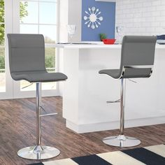 Latitude Run Sitting at the perfect height for kitchen islands, breakfast bars, and pub tables, bar stools have a leg up on other seating options. Take this bar stool for example: perfectly suited for your home's contemporary aesthetic. White Bar Stools, 30 Bar Stools, Swivel Bar Stools, Breakfast Bar Chairs, Breakfast Bars, Kitchen Counter Stools, Mid Century Modern Decor, Foot Rest, Upholstery