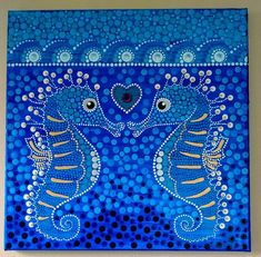 Seahorse love is a dot art painting on a 12 x 12 inch canvas. Wired and ready to hang on wall. Painted in shades of blue, turquoise and deep purple with white, gold and black accents. The heart is painted in turquoise and embellished with pink and purple crystals. The painting