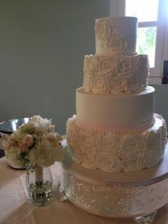4 Tier White Wedding Cake with Rosettes and Pearls from Sweet Ideas-The Cake Shoppe #weddingcakes