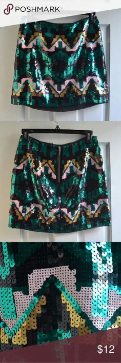 "H&M Geo Aztec Sequin Skirt EU 34 US 4 Geometric Gorgeous H&M Divided skirt with geometric/tribal sequin pattern in emerald green, black, gold, and dusty pink. High waist, silver-tone zipper in the back - just pair with a black bodysuit or shirt for a perfect party outfit! Size is EU 34 US 4. Please note that H&M runs small - this skirt should fit a size 0-2/XS (thus listed as XS). Measurements laying flat (stretches a bit additionally): waist 13.5"", hips 17.5"", length 14"". Worn once…"