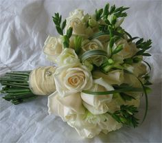 Vandella roses and freesia with grass cage