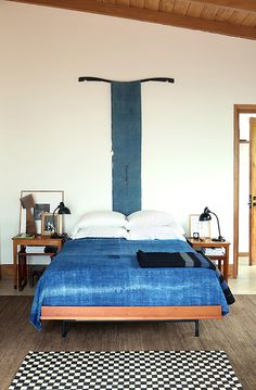 Clean & Simple - Love the wood frames from the bed to the ceiling !