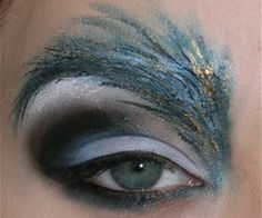 can do without the silly peacock eyebrow, but LOVE the dramatic coloring on that eyeshadow!