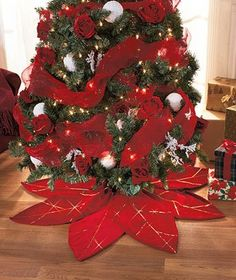 A shimmering Poinsettia Tree Skirt will dress up your Christmas tree in style.