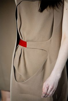 Hussein Chalayan F/W 2012.  Love the pop of red against the neutral beige