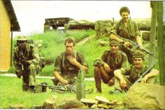 Rhodesian Soldiers take a break, and pose for the camera during the bush war, 1970's