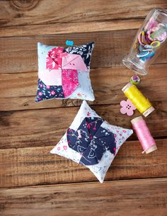 I'm joining some other bloggers today in sharing our own versions of this adorable pinwheel pincushion from the Fat Quarter Shop.