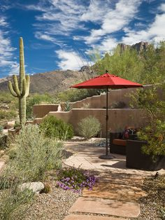 , Amazing Mediterranean Patio With Comely Desert Landscape Ideas Also Red Canopy Umbrella With High Cactus Plant Also Stones Footpath Also Bricks Ground Accent: Beautify Your Yard with Desert Landscaping Ideas
