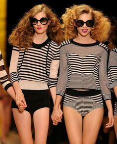 Models wear designs from the Sonia Rykiel spring/summer 2011 collection at Paris Fashion Week