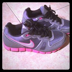 Grey charcoal and hot pink nike 5.0 running shoes Only worn for 30 min work out...perfect condition Nike Shoes Athletic Shoes