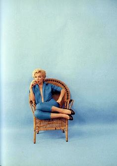 a chair and colored background , marilyn looks great in this picture