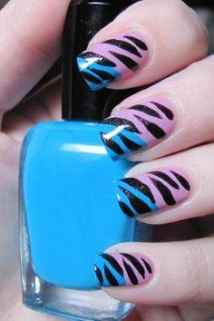 The Sideswipe (aka diagonal   French) nail art with Zebra stripes: Pink base coat and diagonal sideswipe of aqua blue embellished with Zebra stripes