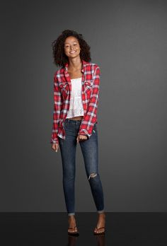 """""""Destroyed skinny jeans add a little attitude to a pretty lace top. Layer on a warm flannel and the signature scent of Abercrombie & Fitch, Perfume No. 1."""""""