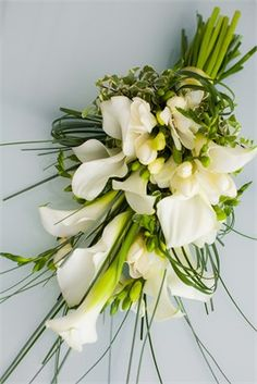 White wedding bouquet of calla lilies, freesia, steel grass and variegated pittiosporum. An 'over the arm' bouquet