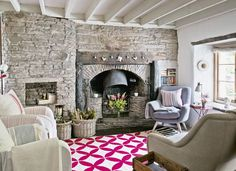 Country Living Room with Stone Wall and Fireplace