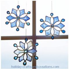 easy christmas crafts snowflake-dip each string in glue lay on template over top of wax paper.  When all strings down on wax paper, add glue and watercolour to middle and let dry.