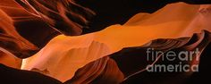 Upper Antelope Canyon in Paige Arizona painted in light filling the canyon from narrow slots above.