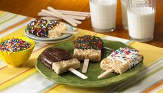 crispie treats shaped like popsicles, dipped in  melted candy.
