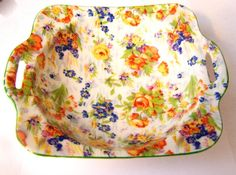 A Lovely Colorful Handled Chintz Dish .