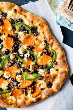 sweet pOtatO black bean pizza gOat cheese