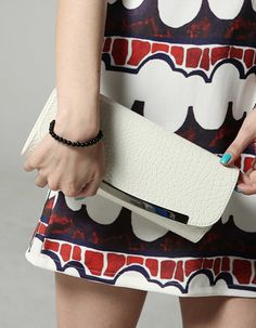 Feminine style slim design clutch. Good match with chic styling. Dispatchable chain strap to wear long or short.