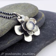 Fleur ~ simple Sterling silver flower little pendant with natural blue chalcedony by gemheaven, £38.00