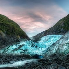 "A Few years ago my 8-year-old son and I went on a decent hike to the base of the Franz Josef Glacier on towards the west coast of the southern island. Once we got close to it, we could see the icy blue cave where a glacial-white river emerged. Awesome! My son looked at me and said, ""Wow. I feel like we just discovered Atlantis!"" - FRANZ JOSEF, NEW ZEW ZEALAND - photo from #treyratcliff Trey Ratcliff at http://www.StuckInCustoms.com"