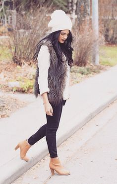 Clothing Ideas - White long sleeve sweater. Fur vest. Black jeans. Ankle boots.