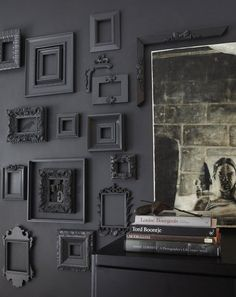 Black frames on black wall