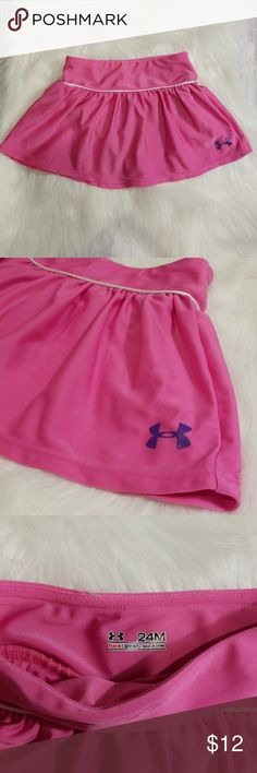 UNDER ARMOUR PINK ATHLETIC SKIRT SIZE 24M Very cute pink athletic skirt line and snaps at the bottom for easy changing has purple logo on the front and excellent condition. Heat gear. 85% polyester and 15% elastane freshly laundered and ready to ship to you quickly as we strive for repeat customers. Under Armour Bottoms Skirts
