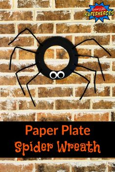 """This Paper Plate Spider Wreath is a spook-tacular craft for your kids to make and will look creepy """"crawling"""" on your front door this Halloween."""