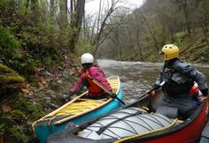 Rhesa B. and Jimmy H. discuss a route through the rapids during an OC1 course at the the Nantahala Outdoor Center.  This was day 1 on the Little Nantahala River (NC).