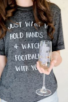 Football and bubbly DO go together! Watch your next football game inthis cutie t-shirt from Live Love Gameday. Photography: Annie Randall Photography | Concept & Styling: Victoria Canada | Location: Royal Palms Resort and Spa | Event Design: Football Bettys | Paper Products: Dear Sarah via Page and Mason Designs #tshirt #footballshirt #champagne #washitape #glitter #gamedaystyle #football #womenwholovefootball