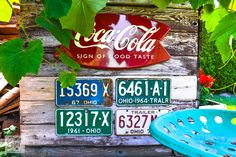 Rustic garden shed via Funky Junk Interiors - coke sign, vintage license plates