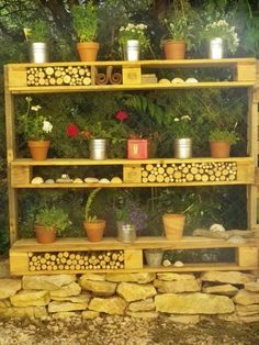 Outdoor pallet shelf - love the cubbies filled with sticks.  would probably have to also put cayenne/other repellent against bugs/mice in them.