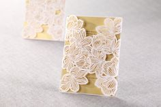 Floral overlay on gold invites by B Wedding Invitations