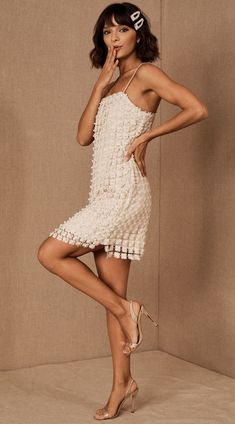 This mini wedding dress from Elliatt Pearl puts a modern twist on a 1920s flapper dress. With all-over embroidery and pearl details, its perfect for a vintage-inspired summer wedding or even a bridal shower or bachelorette party! Head to the link for more unique short wedding dresses. // Photo: BHLDN