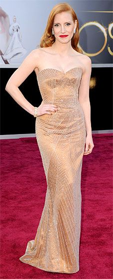 Jessica Chastain wore a strapless Armani Prive gown, Christian Louboutin heels and Harry Winston jewels at the 2013 Oscars.