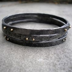 Forged Bangles - Forged Steel 18KT Gold Bangles - Hammered Steel and Gold Bangle Set - Gold Riveted Bangles - Rustic Hammered Bangle Set by lsueszabo on Etsy https://www.etsy.com/listing/265572947/forged-bangles-forged-steel-18kt-gold