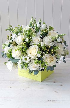 This floral arrangement shows proportion because the amount of white flowers is nearly equal to the amount of greenery. White Flower Arrangements, Table Arrangements, Flower Centerpieces, Flower Decorations, Centrepieces, Silk Flowers, White Flowers, Beautiful Flowers, Deco Floral