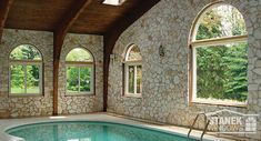 Half-circle and sliding windows allow expansive views of the outdoors from this indoor pool room. Sliding Windows, Windows And Doors, Exterior Colors, Interior And Exterior, Windows Photo Gallery, Window Grids, Window Company, Shaped Windows, Home Estimate