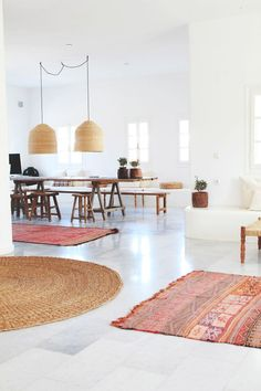 dining room with white marble floor and wooven carpets