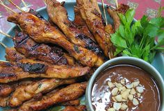 Chicken Satay... I have never tried making this on my own, but this recipe makes it look simple. My kind of yummy!