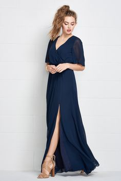 Chic yet wearable, this V-neck Inna Chiffon gown features an elastic waist that not only flatters your figure, but is also comfortable. Flowing sleeves and a daring slit complete this laid-back look. Aqua Blue Bridesmaid Dresses, Discount Bridesmaid Dresses, Bridesmaid Dresses Plus Size, Bridal Dresses, Bridesmaid Ideas, Pastel Bridesmaids, Bridesmaid Gowns, Poses, Chiffon Gown