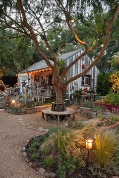 I love this garden room...the lights and paths, seating all surrounding a lovely cottage shed