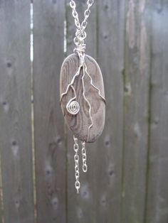 California driftwood necklace, pendant wrapped with sterling silver wire Love!