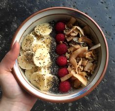 Quiona bowl with maple syrup, vanilla extract, almond milk, coconut granola, coconut flakes, chia seeds, raspberries and banana!